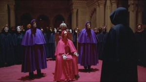 Tom Cruise, in the black cloak on the right, gets the third degree from Kubrick's Illuminati.