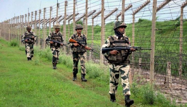 Indian commandos patrol border with Bangladesh.